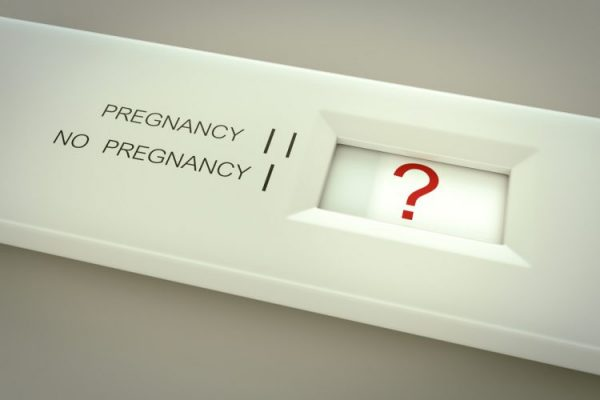 Stick pregnancy test with question mark in indicator window