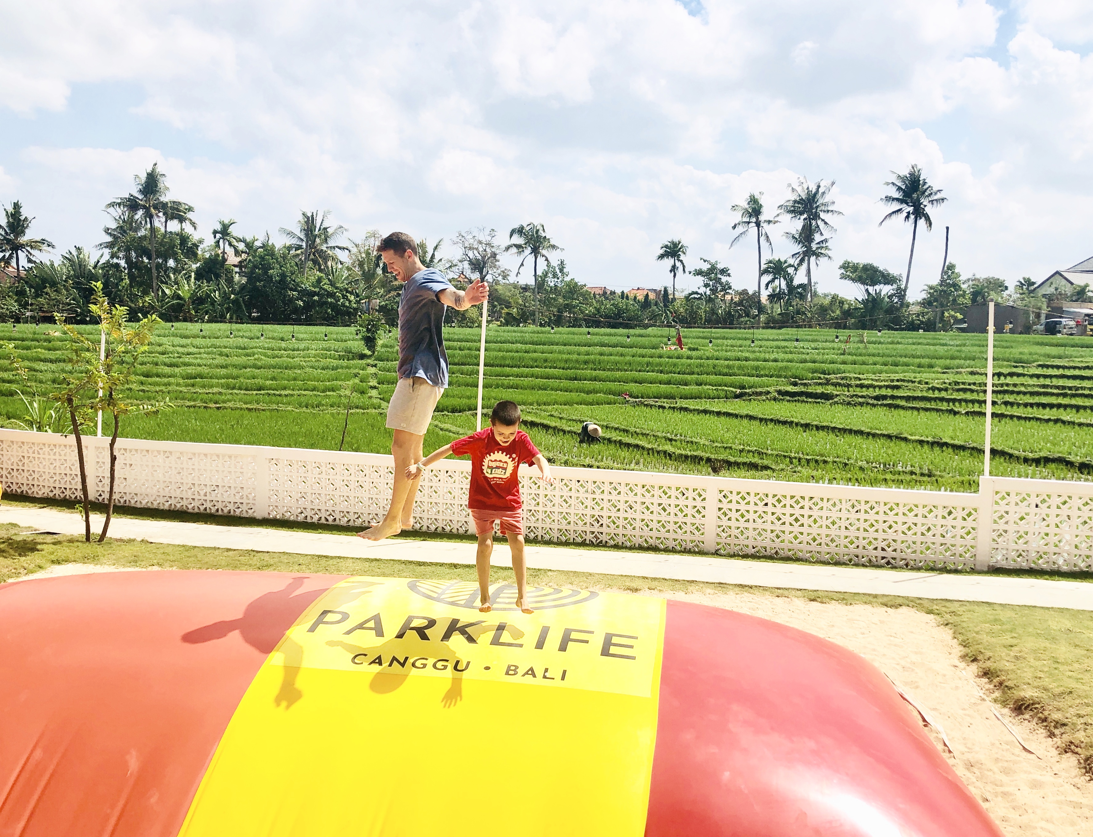 Having super fun on the giant jumping pillow at Parklife in Canggu, Bali.