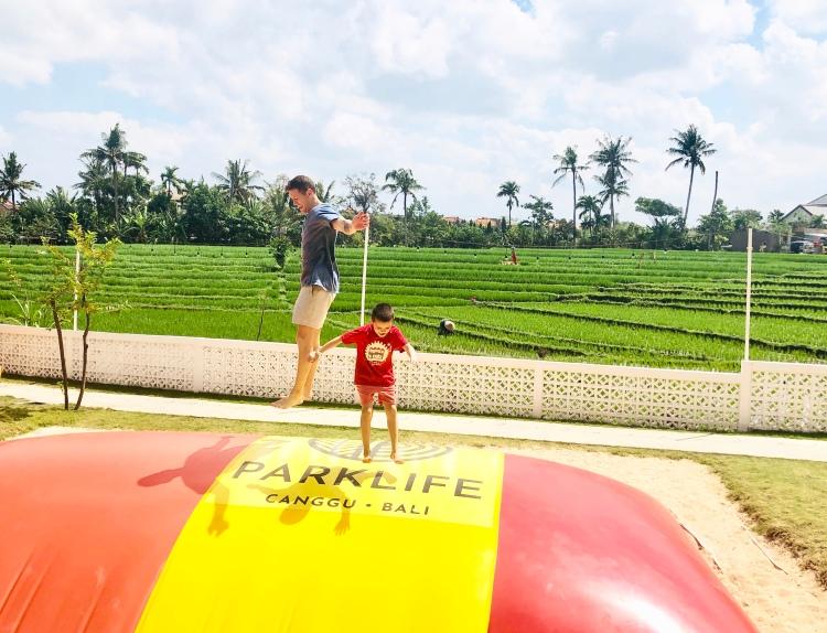Having super fun on the giant jumping pillow at Parklife in Canggu, Bali.